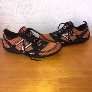 New Balance Vibrant orange & black sneakers